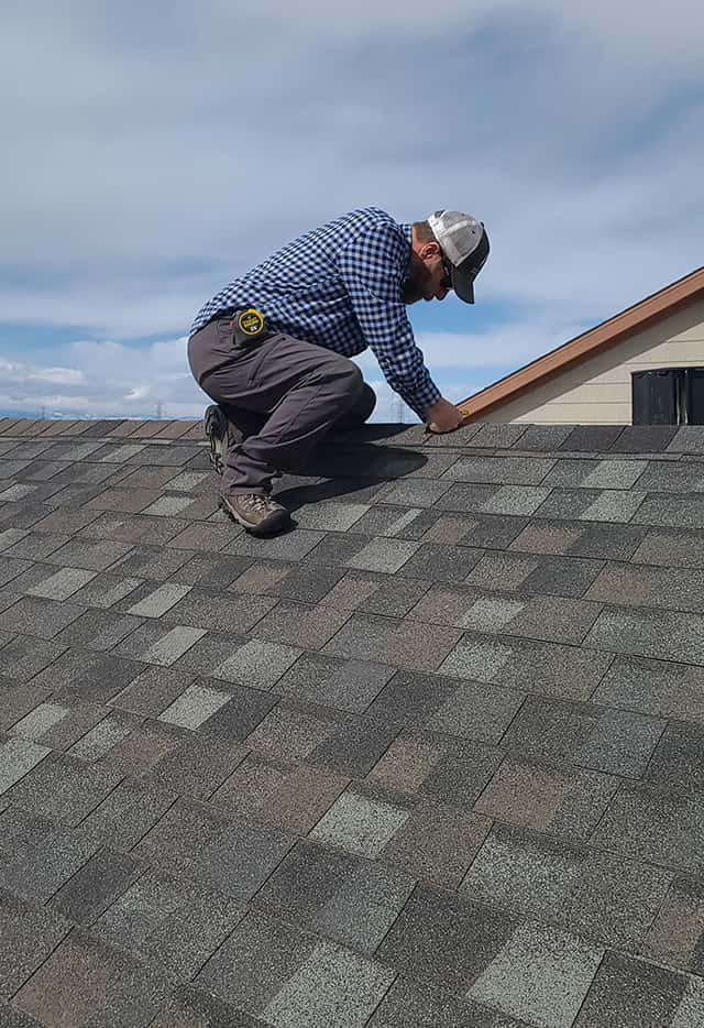Ken performing a free roof inspection in Commerce City near Denver