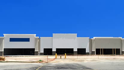 Denver commercial roof installation companies installation a roof on a big retail center