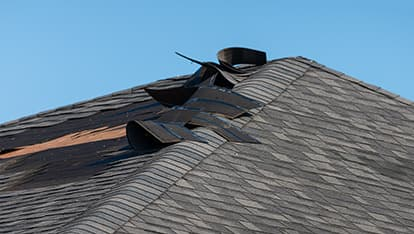 a residential roof neeing repair from wind damage